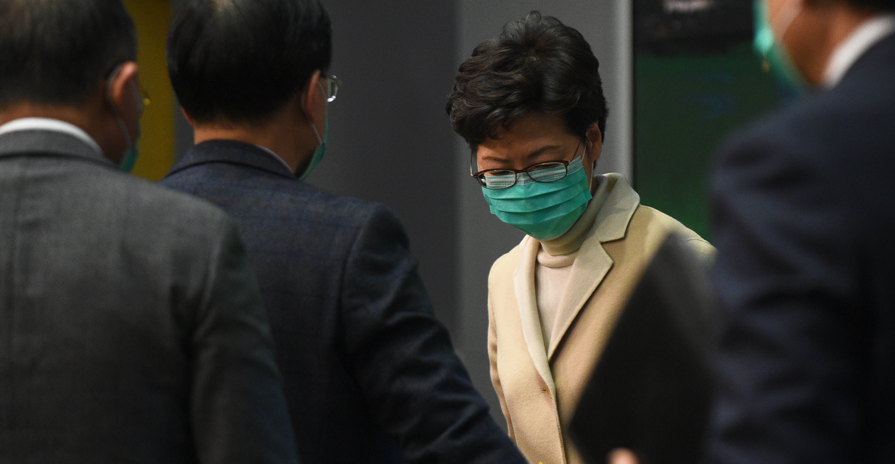 Chief Executive Carrie Lam prepares to leave at the end of a news conference on Jan. 31. Photo: AFP