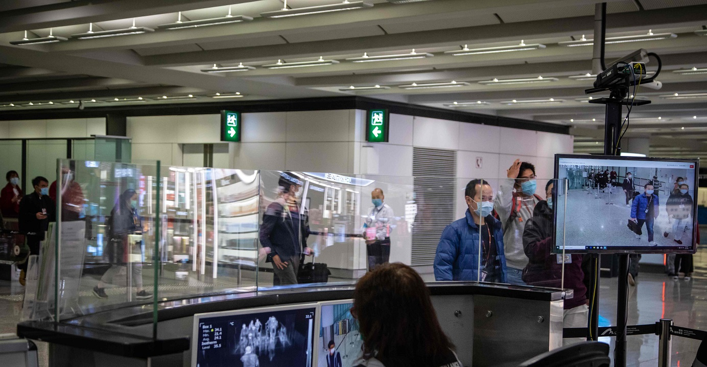 Airport health staff monitor the body temperatures of passengers with thermal scanners in an arrival hall at the Hong Kong airport. The government is beefing up quarantine arrangements on inbound travelers arriving from some regions in Europe and Japan. P