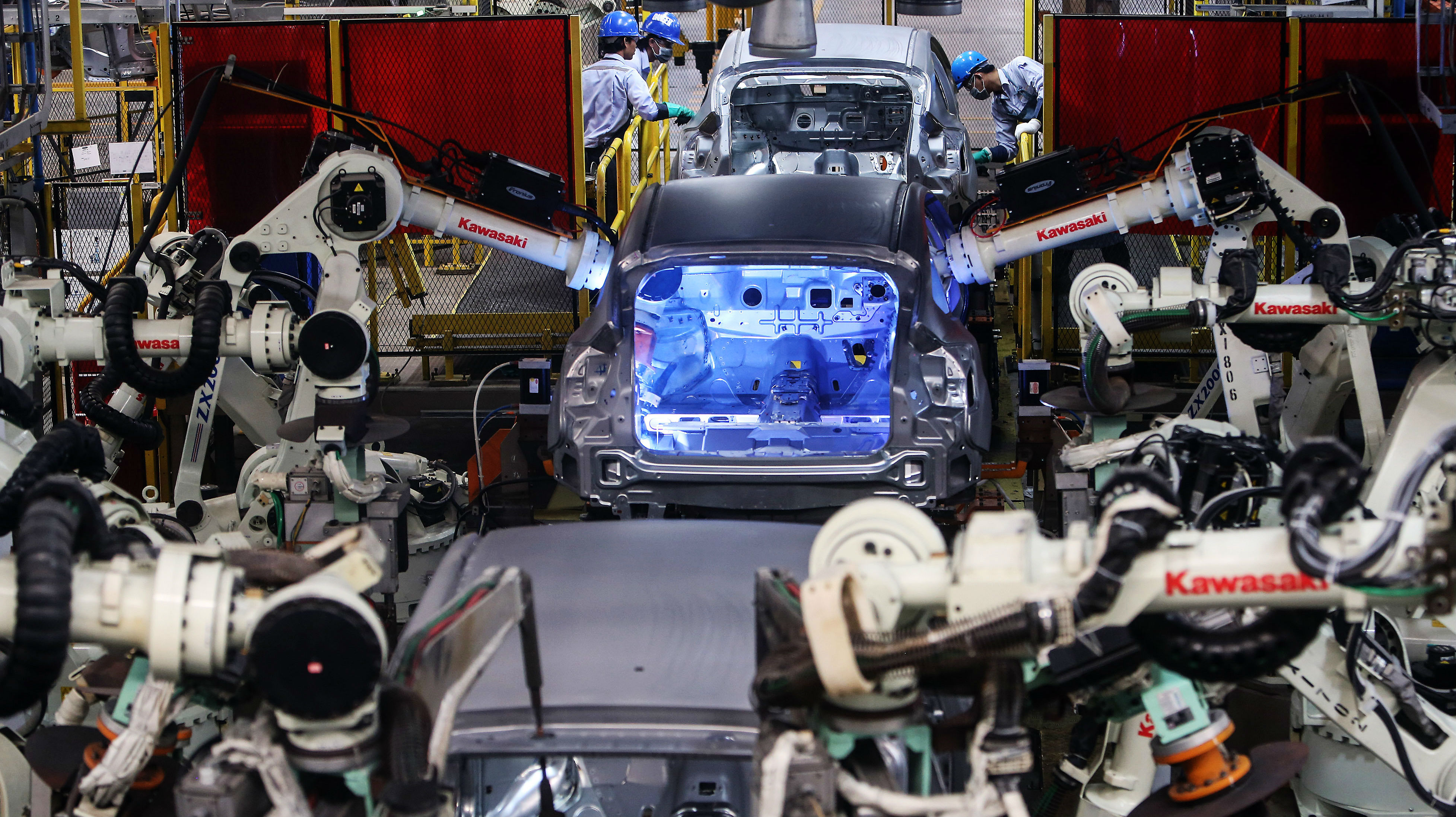 Welding robots work on cars at a Ford factory in Rayong, Thailand. What really matters is whether the jobs outside of the robot-computer economy remain valuable and in high demand. Photo: Bloomberg