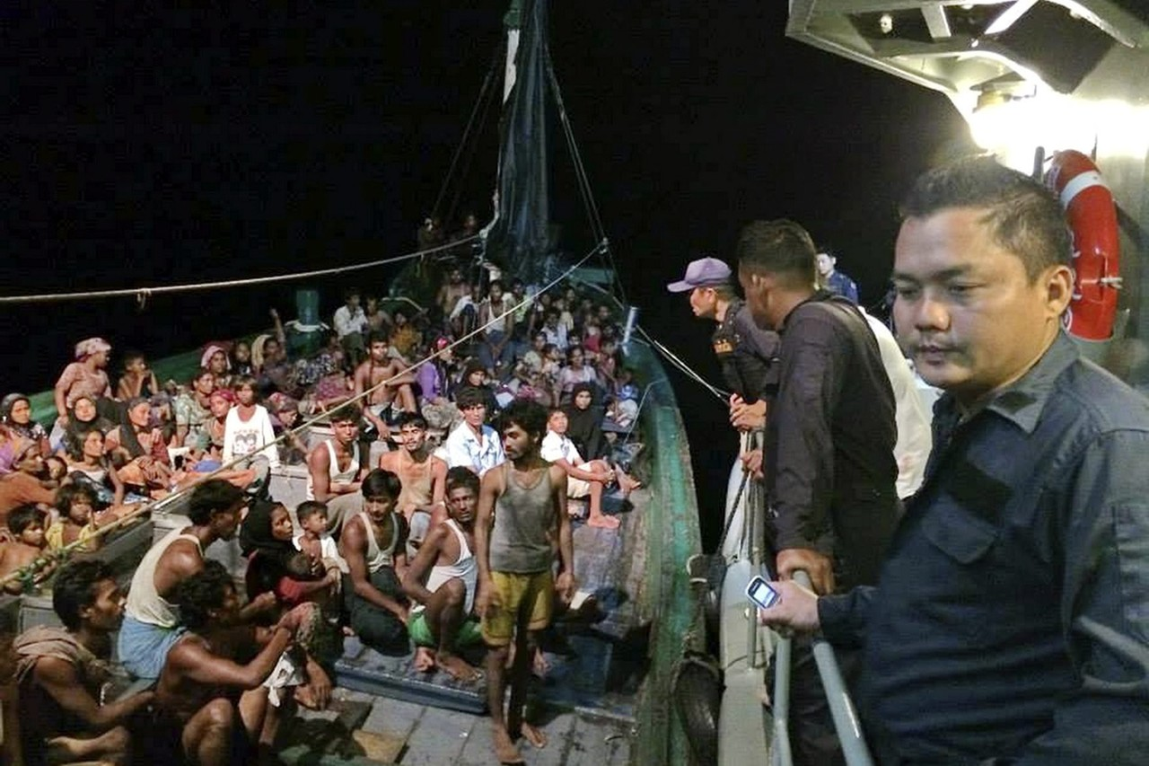 Indonesian marine police prepare to receive hundreds of refugees after the migrants were left adrift at sea for more than a week. Photo: WSJ