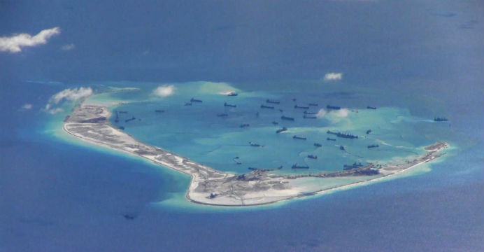 A US surveillance image appears to show Chinese dredging vessels in the waters around Mischief Reef in the disputed Spratly Islands. Photo: Reuters