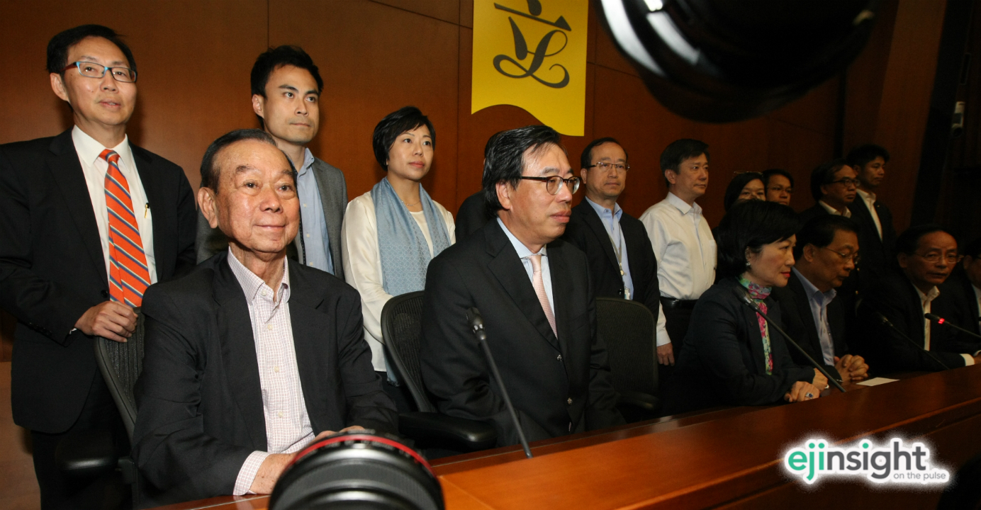 Lau Wong-fat (seated, left) joins fellow pro-establishment lawmakers as they try to explain why they were absent from the historic vote in Legco. Photo: HKEJ