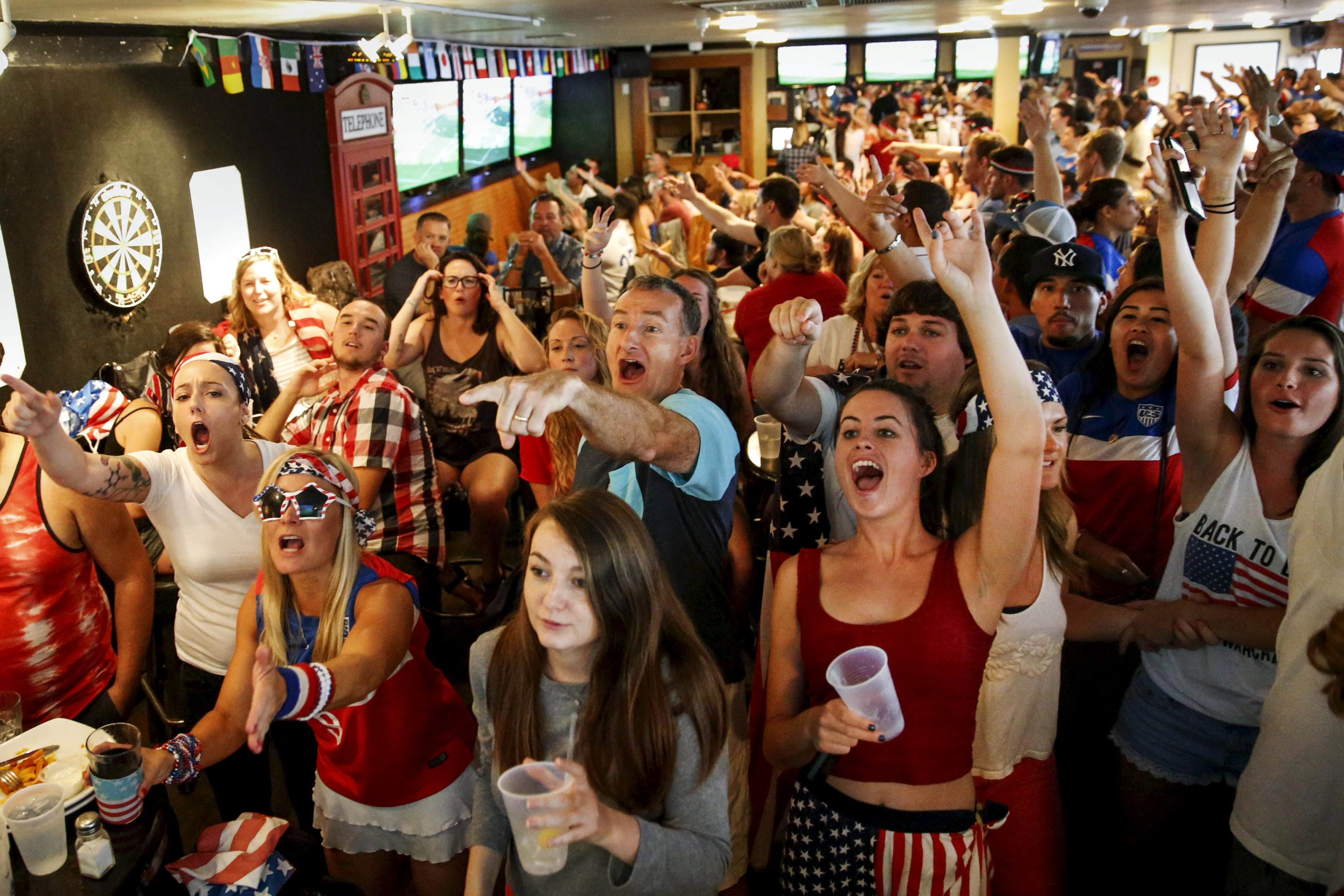 US fans watch the women's World Cup final against Japan on a monitor inside a bar. Fox scored a ratings coup with a record 25.4 million viewers. Photo: Reuters