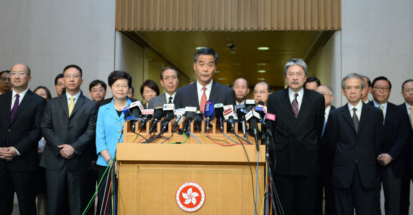 Hong Kong officials also managed to restrain their enthusiasm as Leung Chun-ying welcomed the National People's Congress Standing Committee's electoral reform package on Aug. 31 last year. Photo: Xinhua