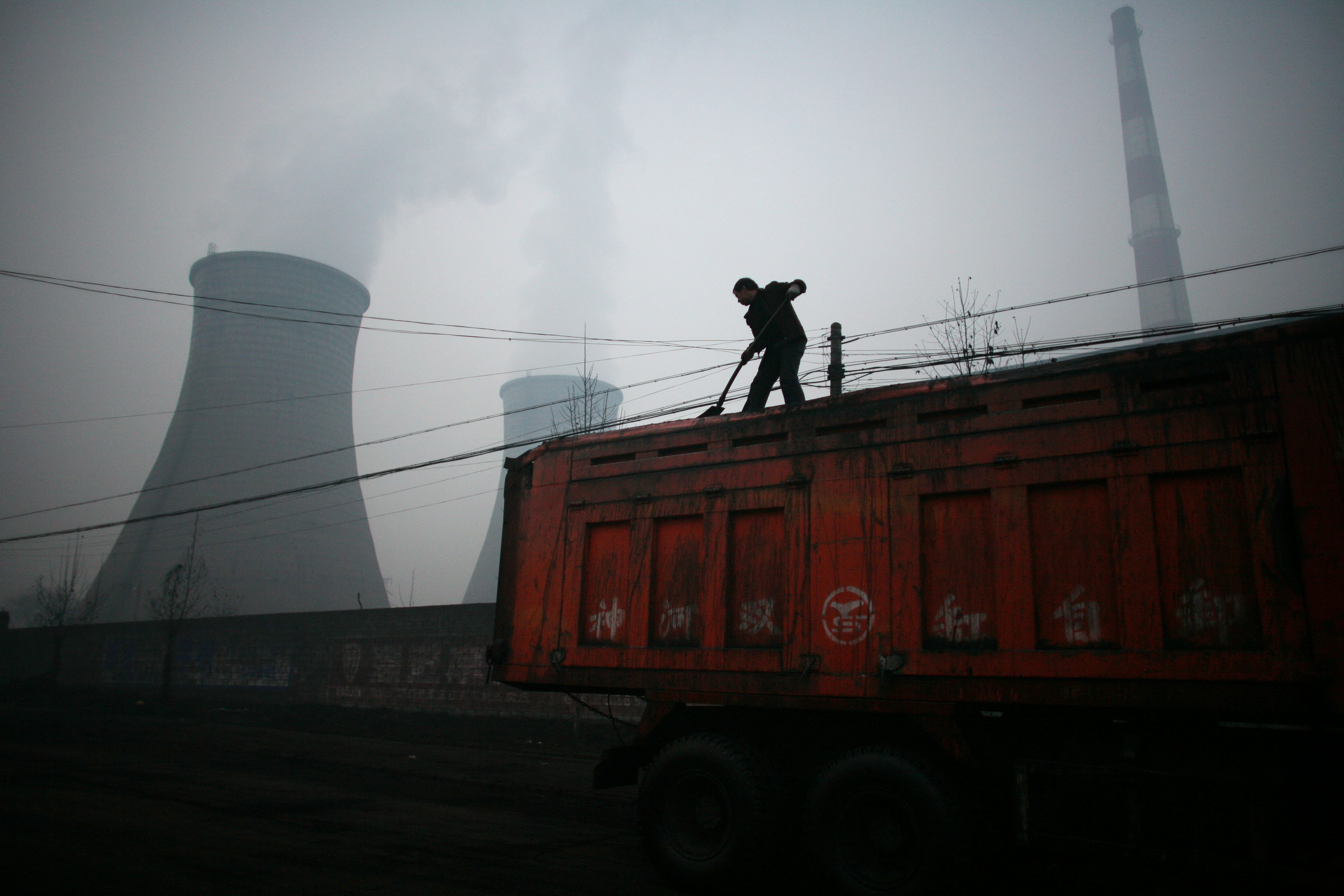 China is pilot testing emissions-trading markets and expects to expand the program next year. Photo: Bloomberg