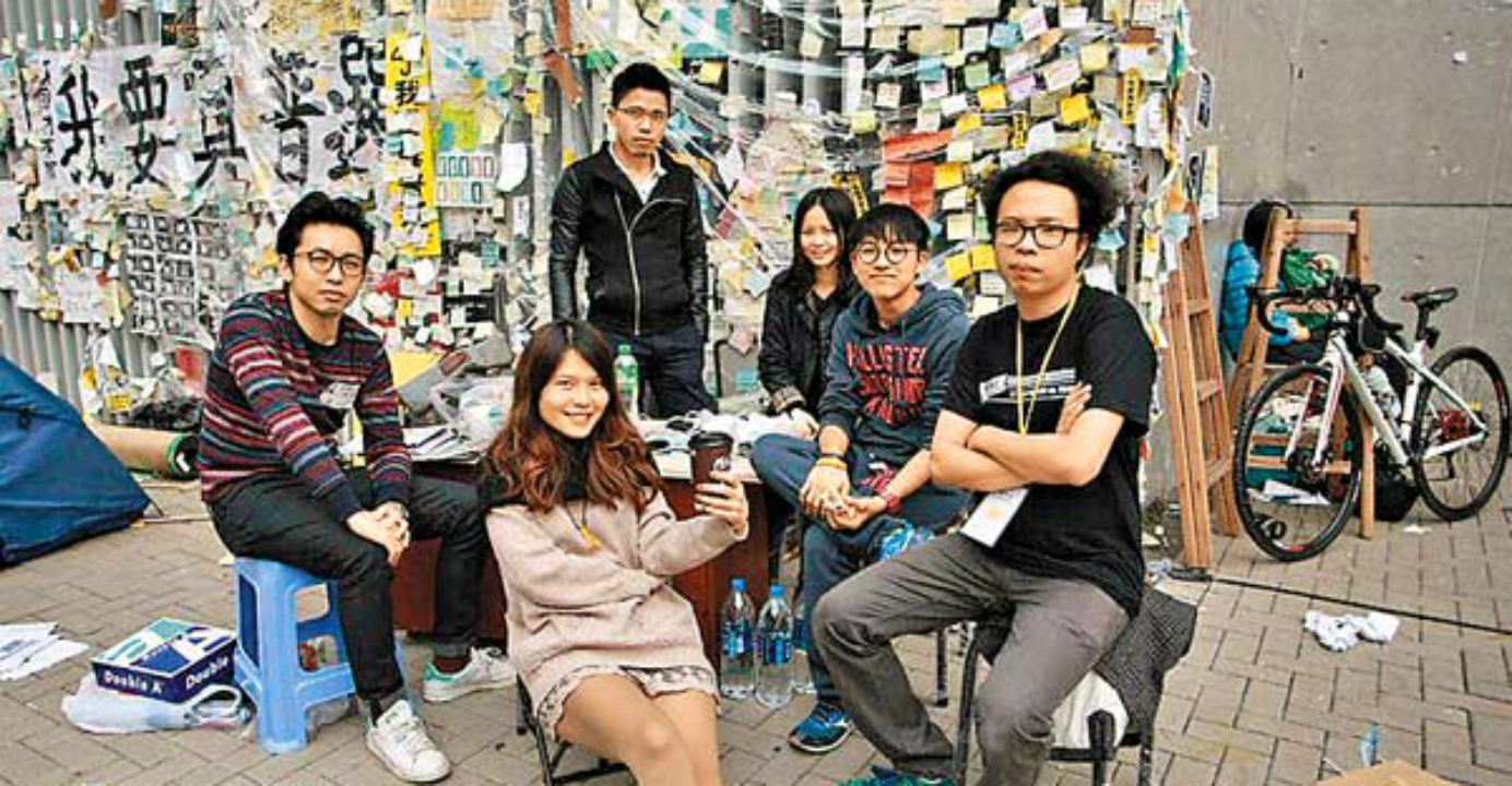 Yeung (center) and like-minded friends formed the Umbrella Movement Visual Archive and Research Collective to preserve artworks from the pro-democracy campaign for history. Photo: HKEJ
