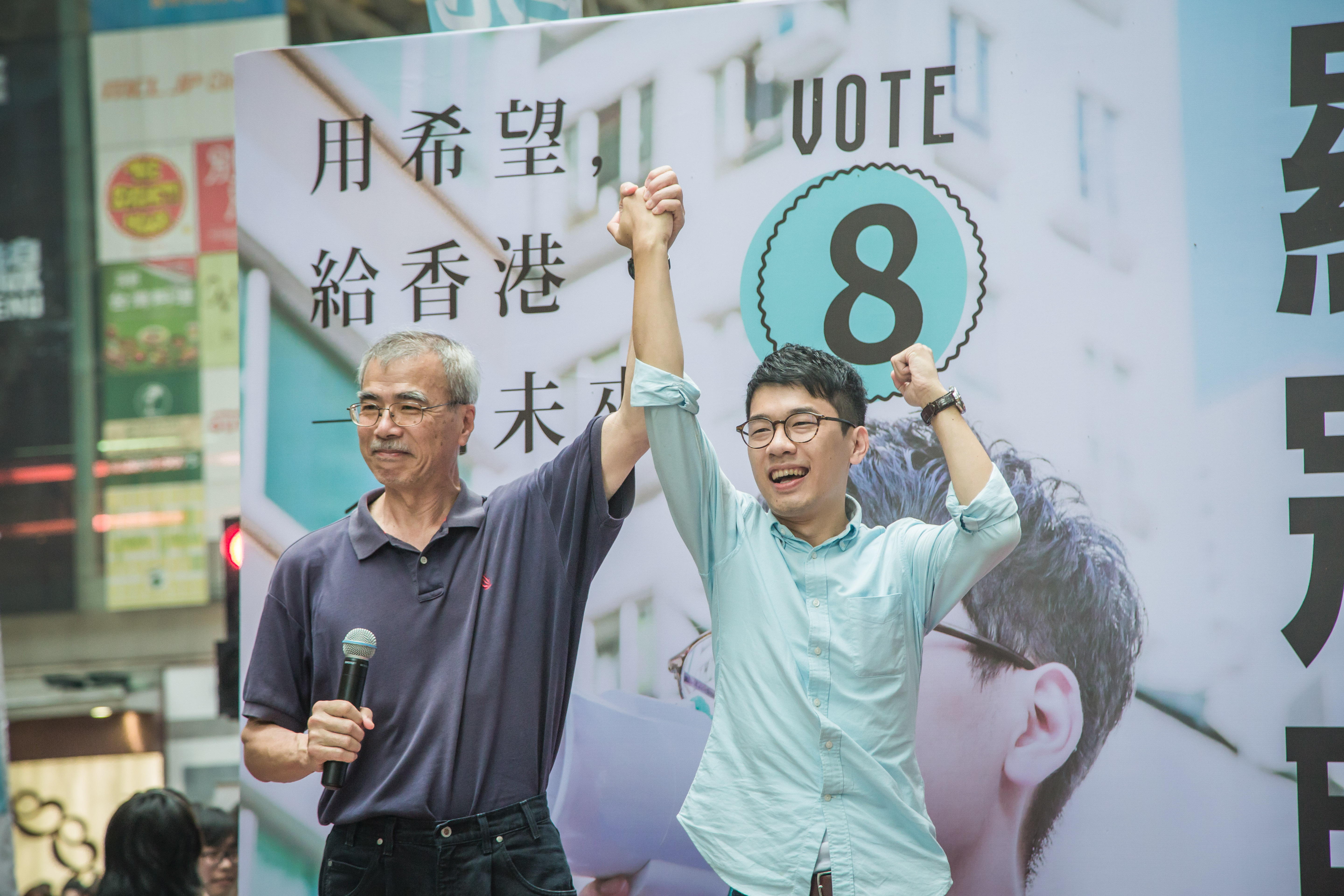 Political commentator Joseph Lian Yizheng (left) is seen with Nathan Law of the pro-democracy Demosistō party during an election campaign event. Photo: Jason940728