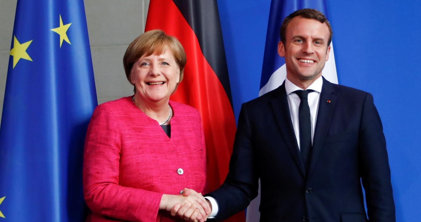 French President Emmanuel Macron (right) wants to meet German Chancellor Angela Merkel halfway on European integration but everything hinges on the success of French reforms. Photo: Reuters