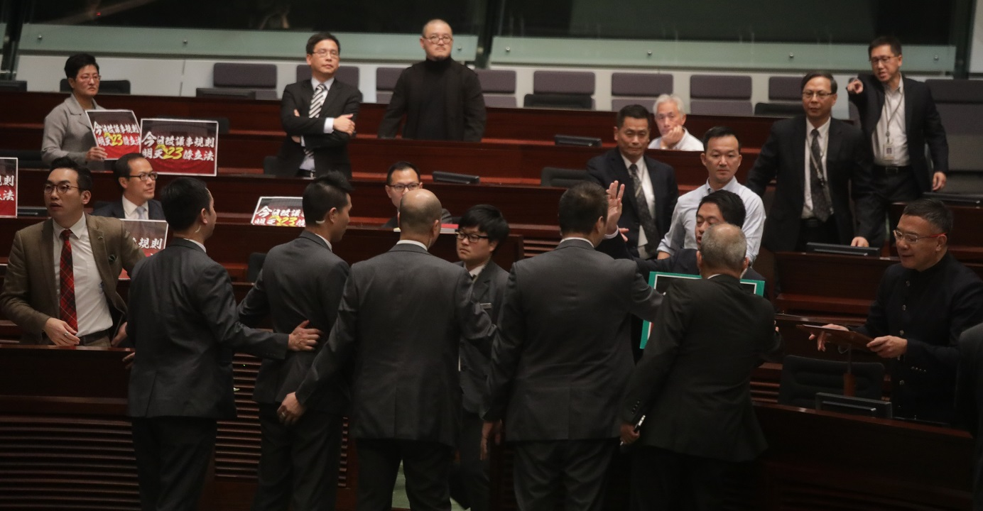 Several pro-democracy lawmakers stage a protest during a Legco meeting. Meanwhile, the pro-Beijing camp is preparing to ramp up the battle over amendments to the Legco rules of procedure. Photo: HKEJ