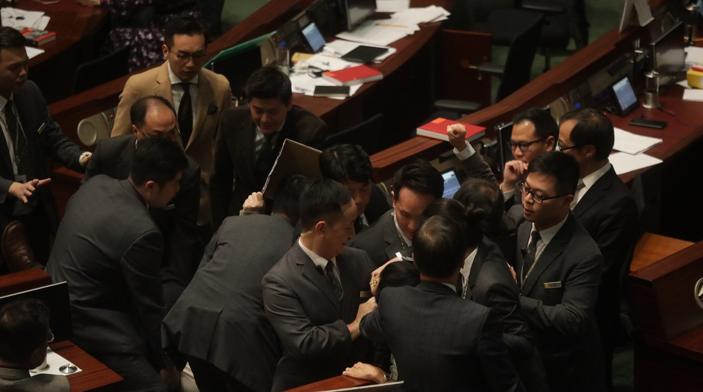 Cheung Chiu-hung and Shiu Ka-chun were among the pan-democrats who staged protests during a debate on Legco meeting rule changes. Photo: HKEJ