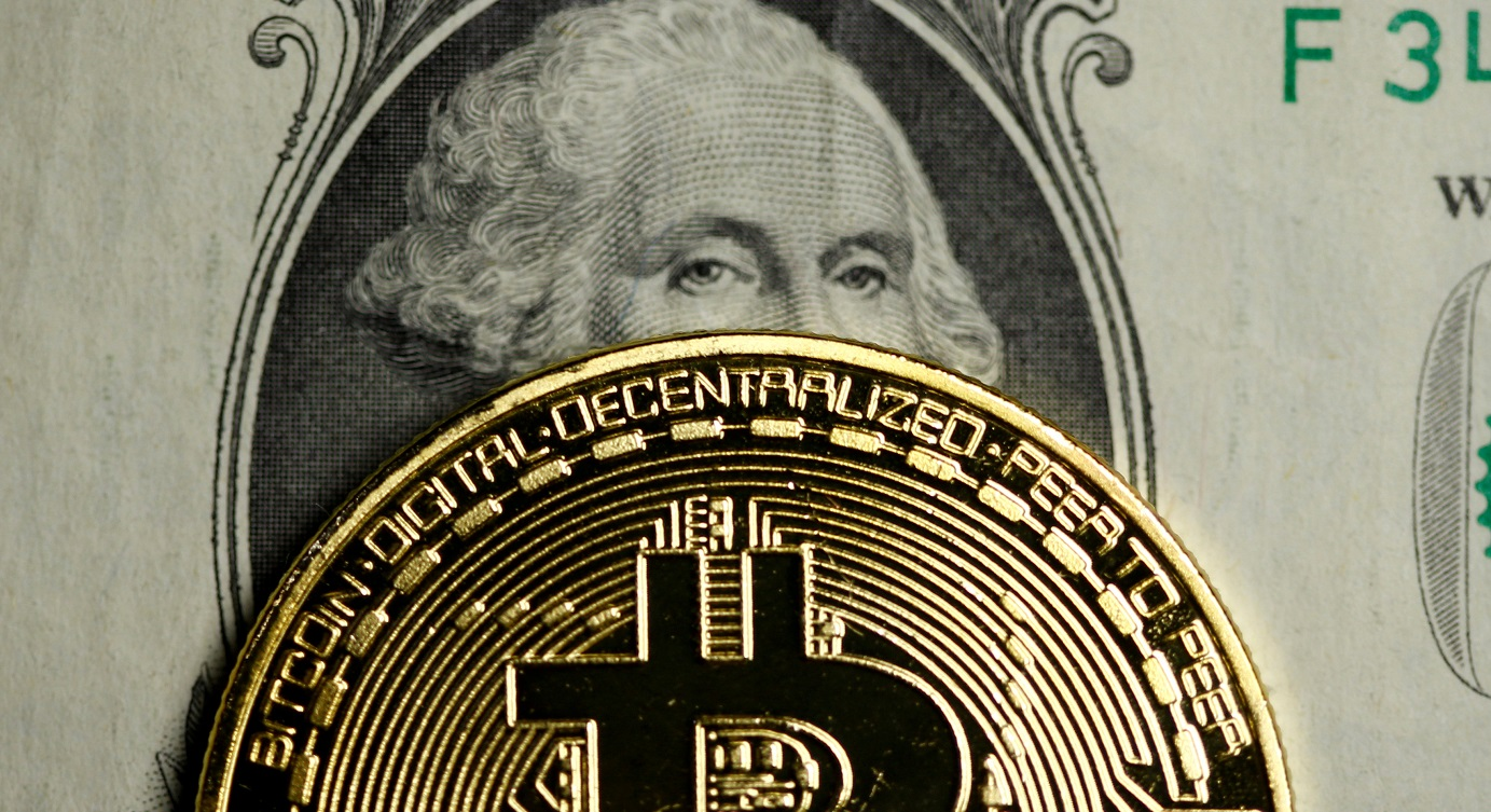 A bitcoin and US dollar note. Circle is set to create a new cryptocurrency pegged to the price of the US dollar, with an aim to address the volatility issue that plagues virtual units. Photo: Reuters
