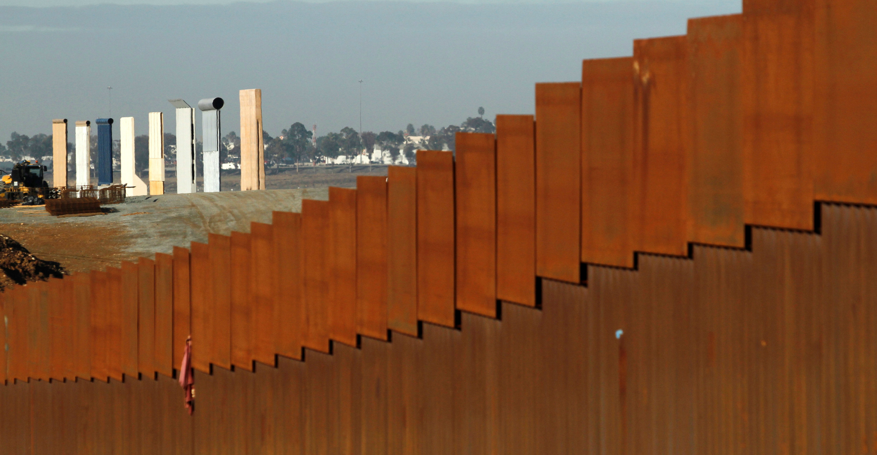 Prototypes for US President Donald Trump's border wall are seen behind the border fence between Mexico and the United States, in Tijuana, Mexico. Photo: Reuters