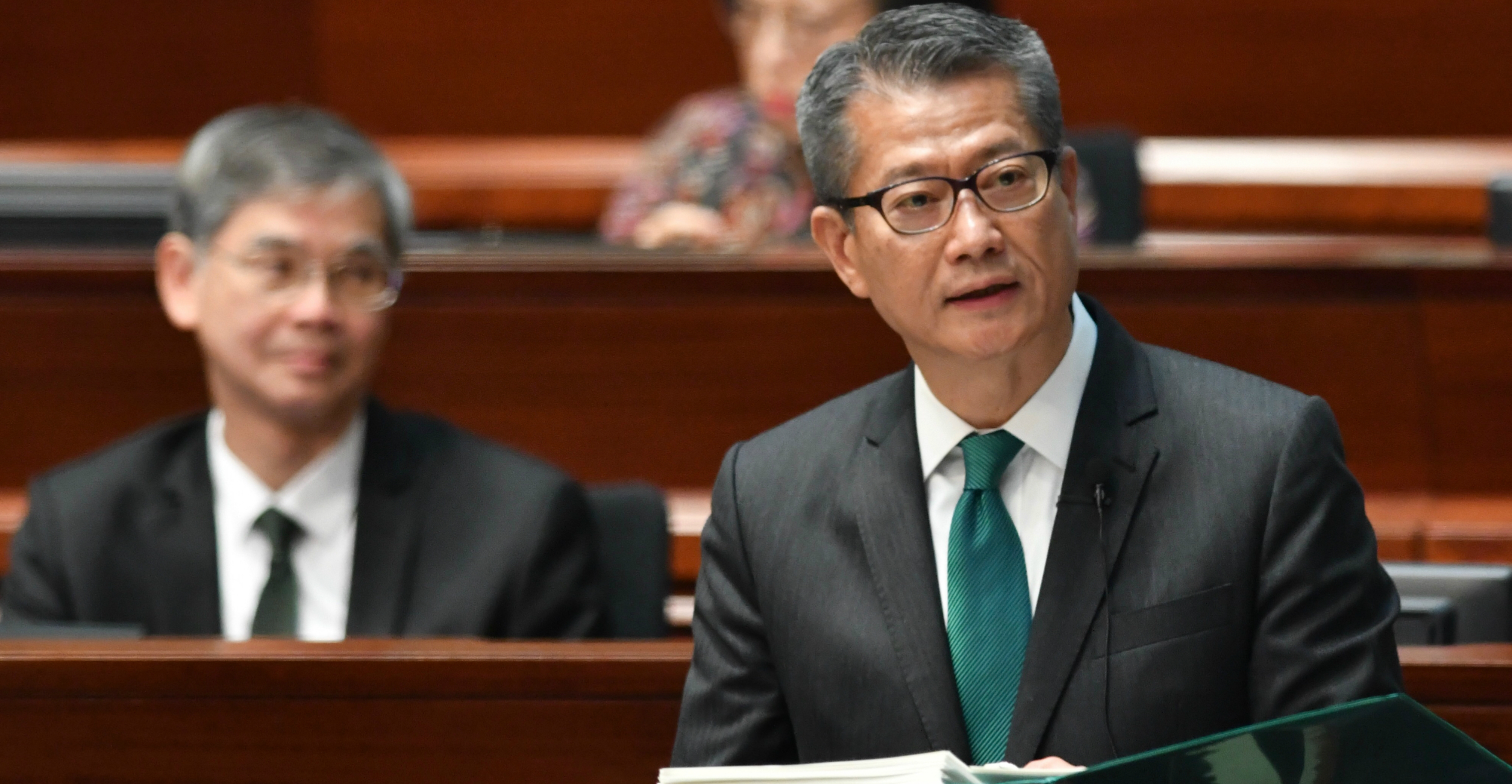 Financial Secretary Paul Chan delivers the 2019-20 budget at the Legislative Council on Wednesday. Photo: ISD