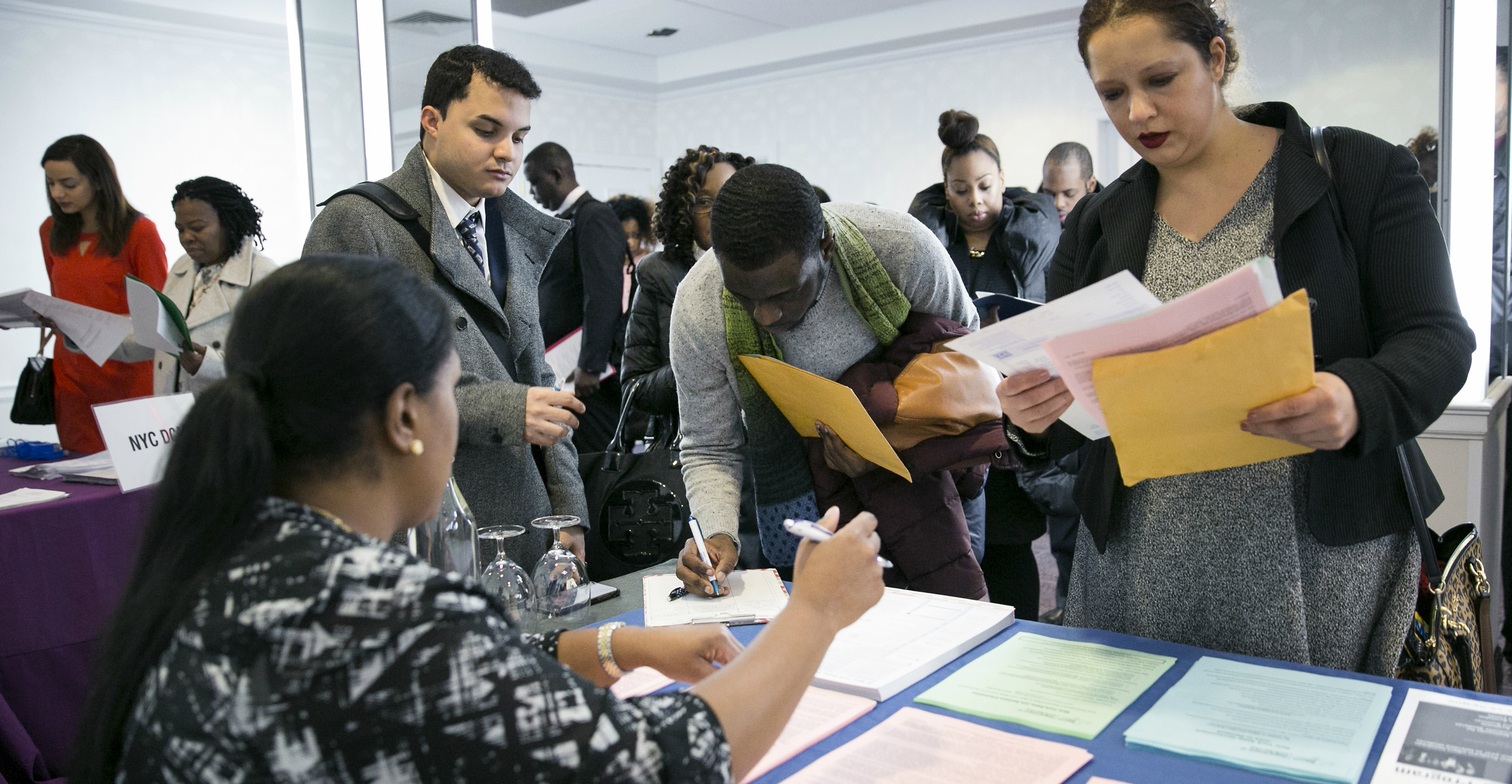 Jobseekers fill out forms at a jobs fair in New York. The old economic theory that asserts a clear tradeoff between unemployment and inflation does not hold true in the US and Britain after the global financial crisis. Photo: Bloomberg