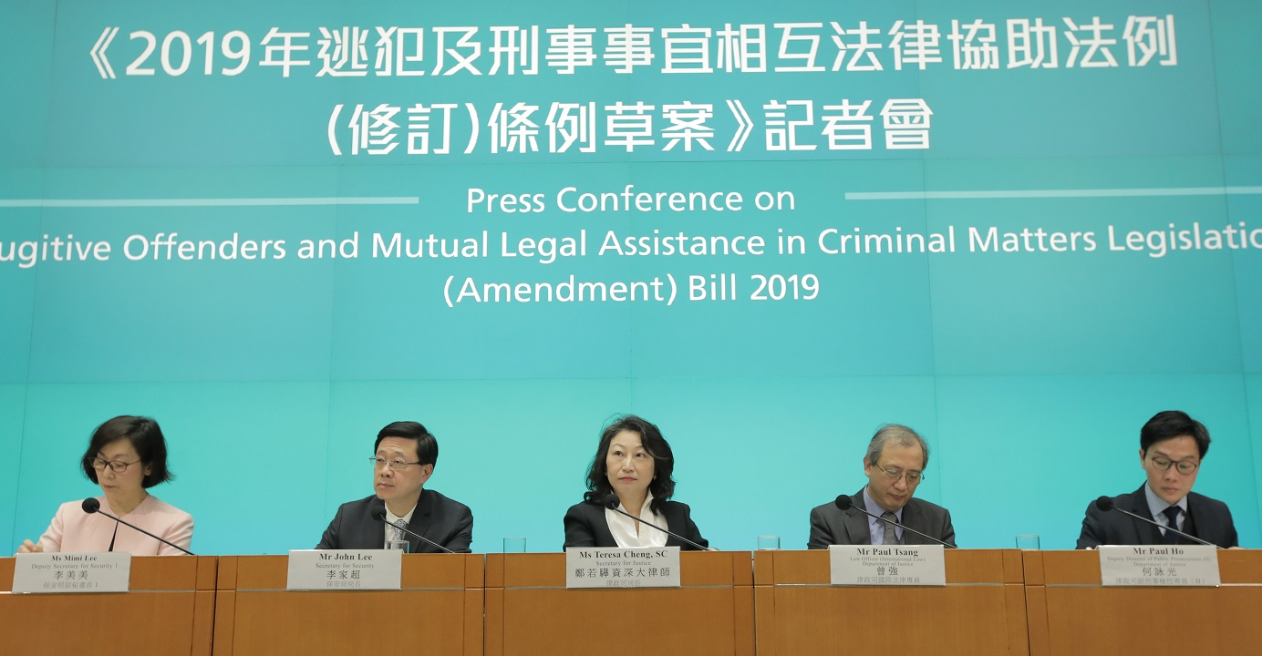 Secretary for Justice Teresa Cheng (center) and Secretary for Security John Lee (2nd left) defend the government's legislative proposal to amend the fugitives law during a press conference on Tuesday. Photo: HKEJ