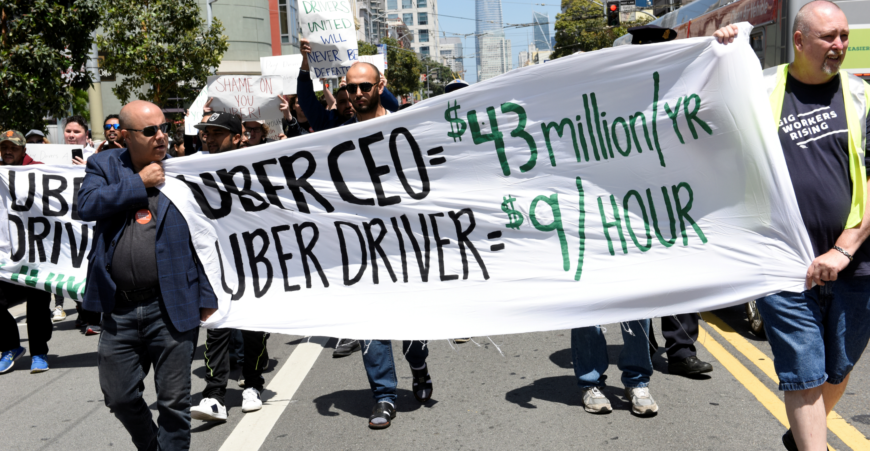 Uber and other ride-hailing firms have faced dozens of lawsuits accusing them of misclassifying workers as independent contractors under federal and state wage laws. Photo: Reuters