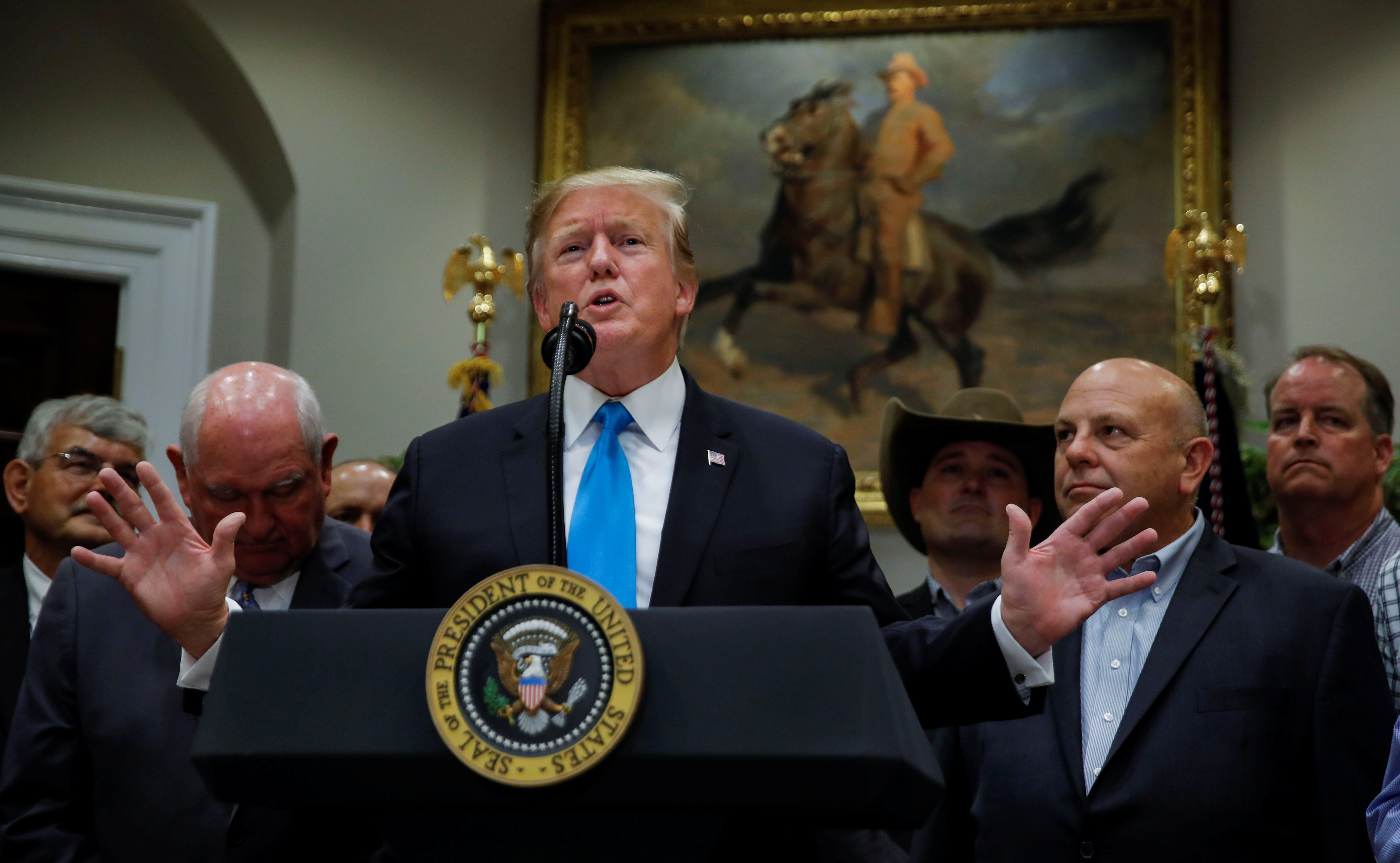 US President Donald Trump speaks to reporters at the White House on Thursday during an event devoted to 'America's farmers and ranchers'. Photo: Reuters