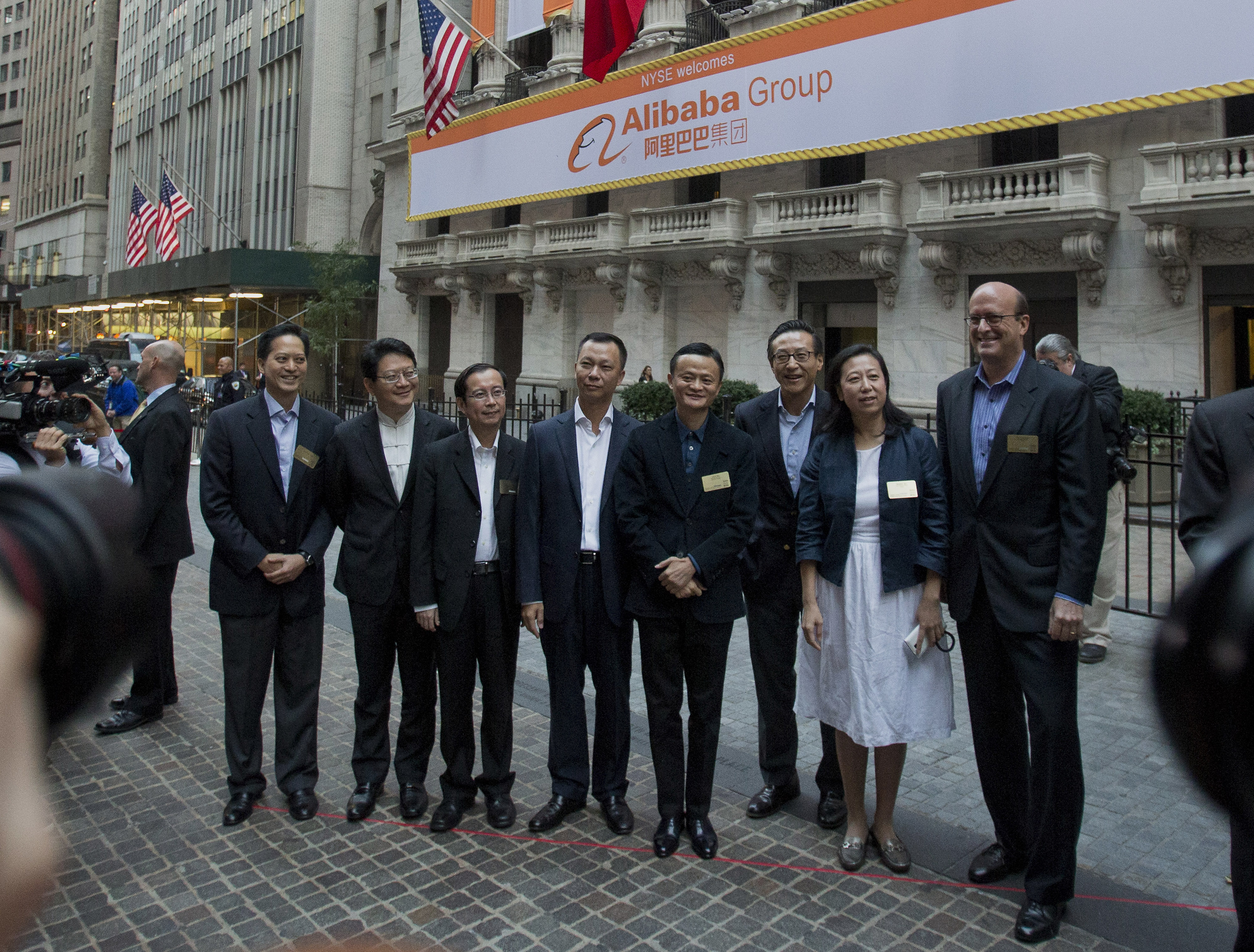 A file picture shows CFO Maggie Wu (2nd from right) with other top Alibaba executives in front of the New York Stock Exchange on Sept 19, 2014 after the firm's listing. Wu has now been given added responsibilities within the group. Photo: Bloomberg