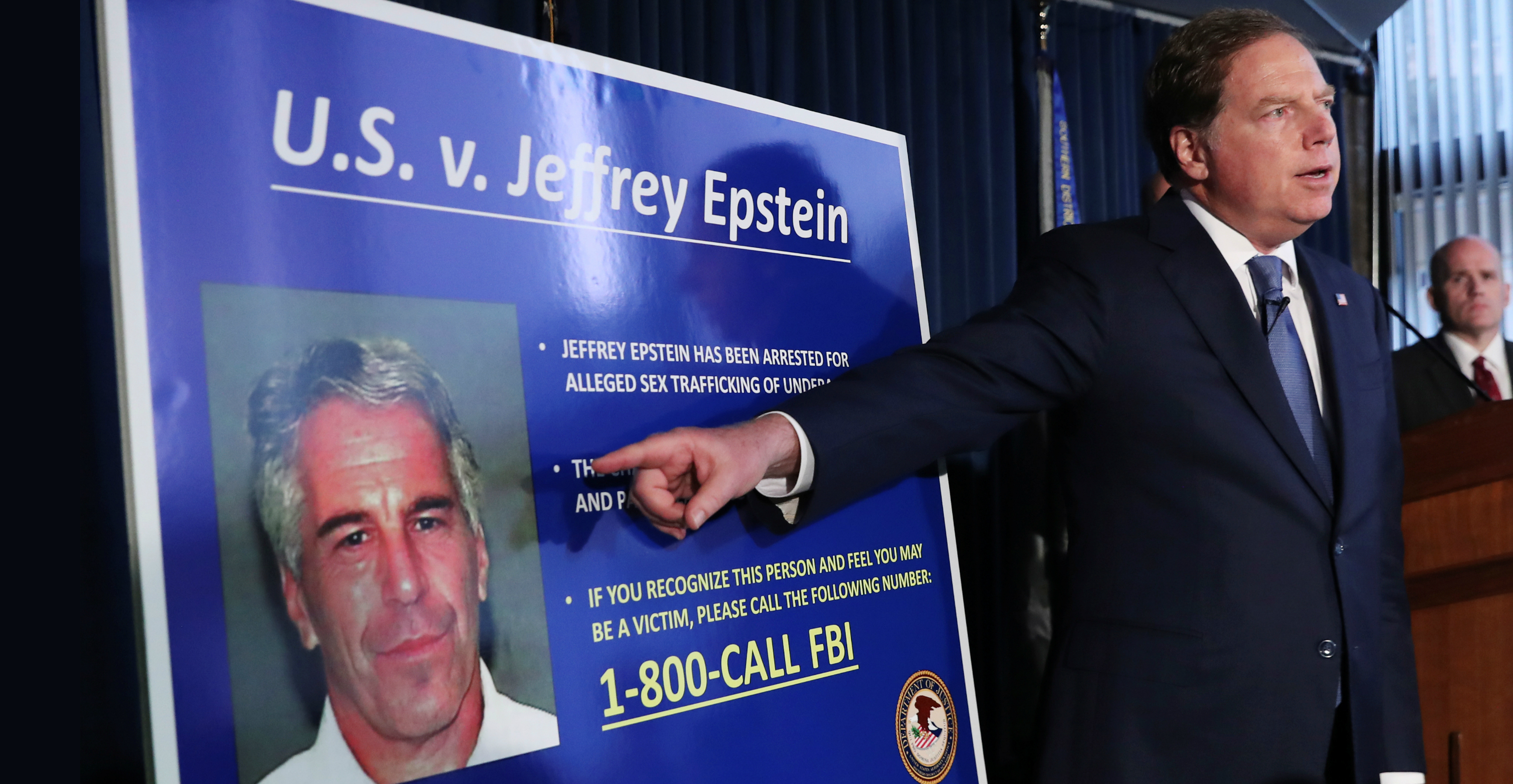 Geoffrey Berman, US attorney for the Southern District of New York, points to a photograph of Jeffrey Epstein as he announces the filing of charges against the financier on Monday. Photo: Reuters