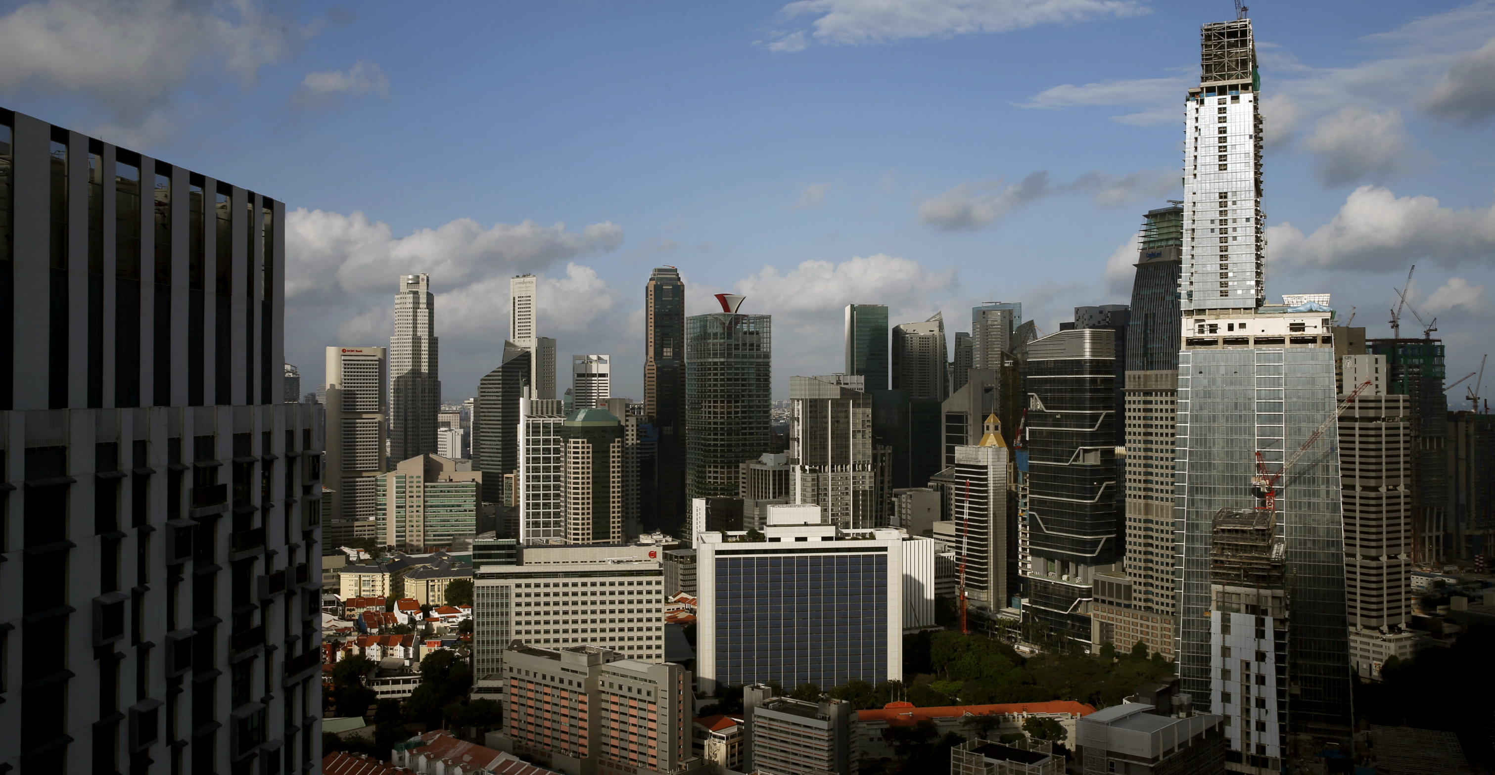 James Dyson bought the three-storey penthouse at the top of Singapore's tallest building, Tanjong Pagar Centre (right), for S$73.8 million (US$54.2 million).  Photo: Reuters