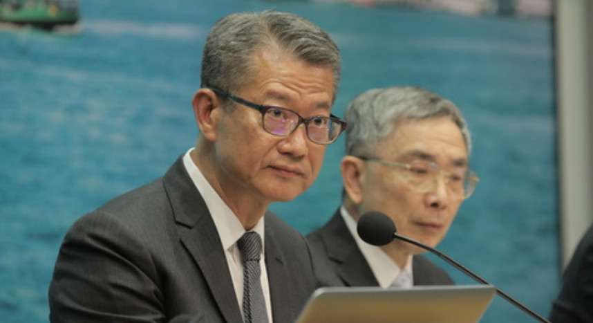 Hong Kong's Financial Secretary Paul Chan speaks at a press conference on Aug. 15 while announcing measures to help businesses and households weather the economic challenges. Photo: HKEJ