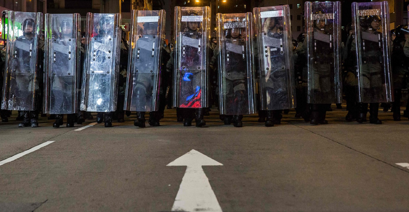 Riot police prepare for a dispersal operation in Mong Kok on Aug. 3. The author says the withdrawal of the extradition bill will help facilitate constructive dialogue and break the current deadlock. Photo: AFP