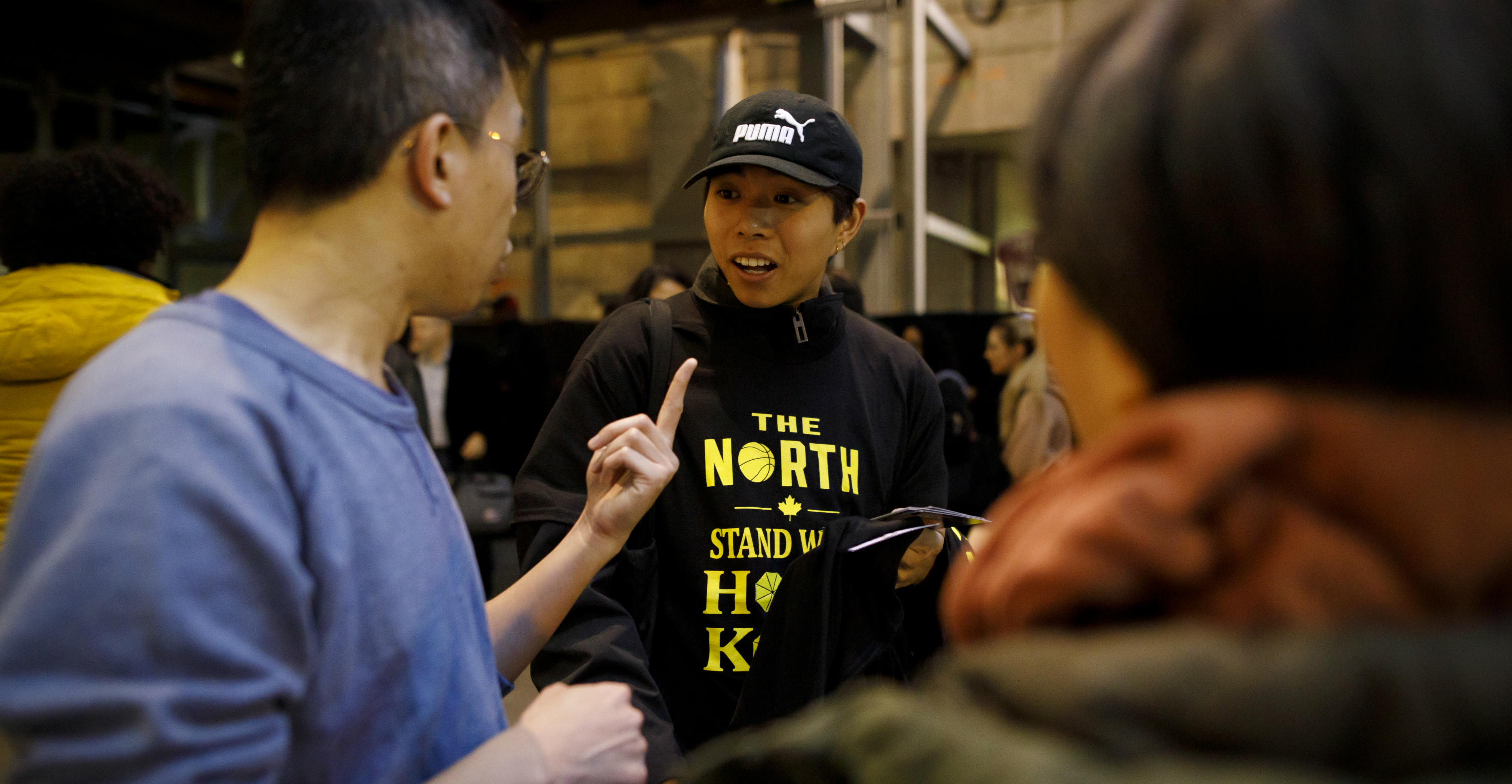 A Hong Kong pro-democracy supporter argues with a passerby as he hands out t-shirts outside the Scotiabank Arena in Toronto on Tuesday. Photo: Getty Images North America/AFP