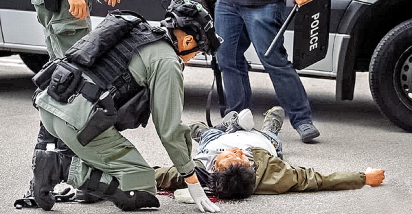 A man lies on the ground with head injury as anti-riot police enter the Lakeside Garden housing complex in Sai Kung to make arrests amid an anti-quarantine center protest on Sunday. Photo: Facebook page of Editorial Board of CityU Students' Union