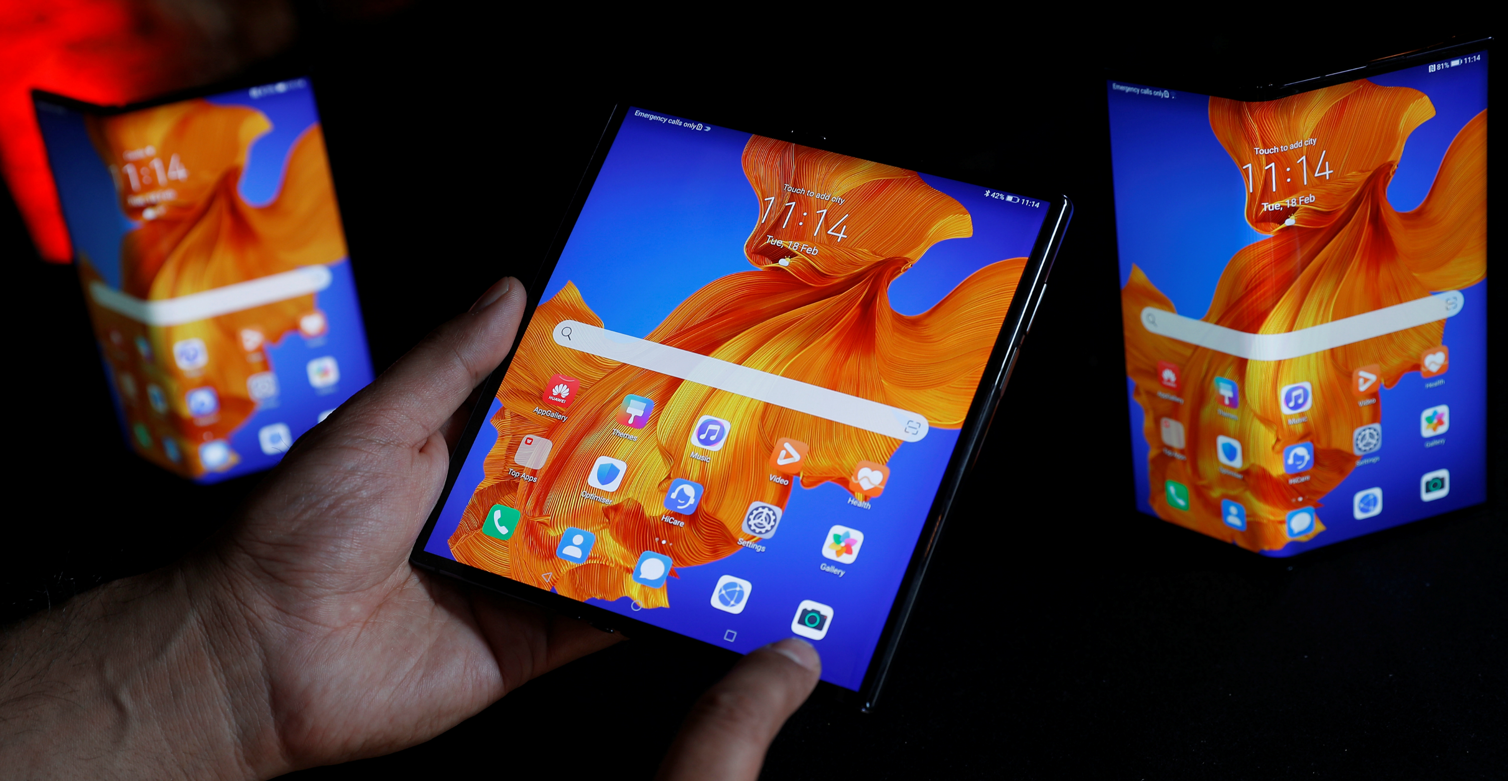 A Huawei employee demonstrates the features of the Mate XS, the company's latest foldable-screen smartphone model. Photo: Reuters