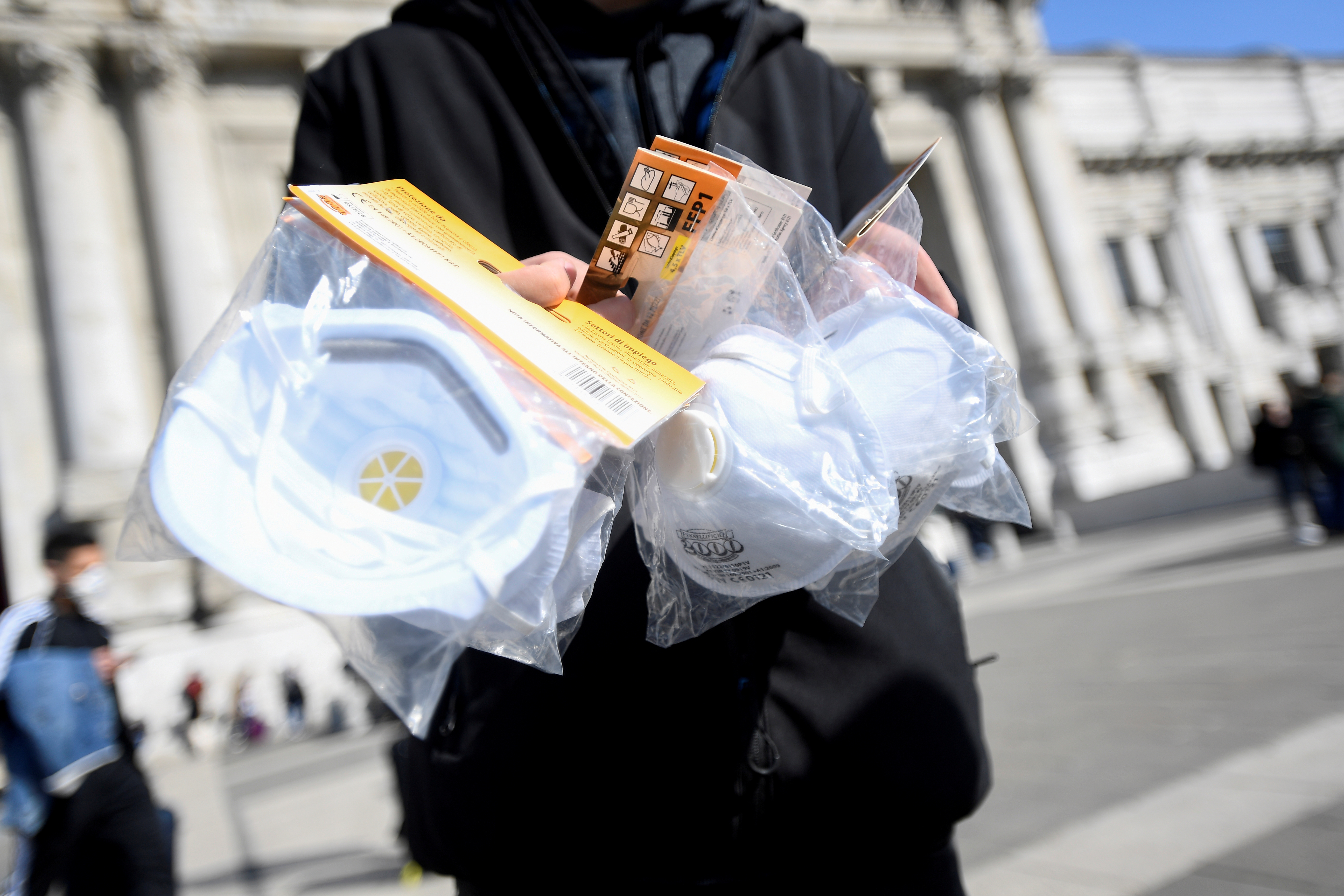 A street vendor sells face masks outside a railway station in Milan following the coronavirus outbreak. Italy, South Korea and Japan have all seen a spike in infections, sparking fears of a global pandemic. Photo: Reuters