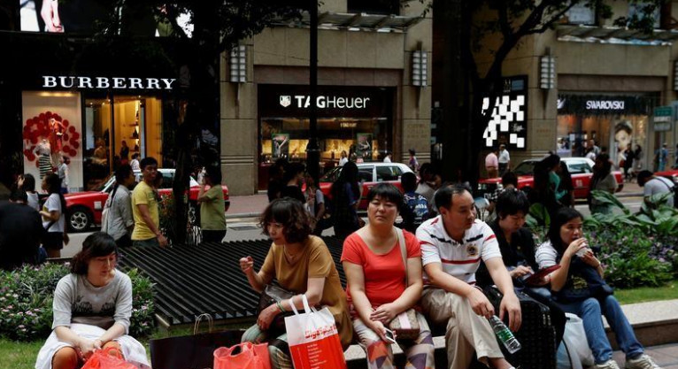 A view of Russell Street which earned the distinction of being the world's most expensive retail street. Following a golden period, Hong Kong's property market faces many uncertainties now. Photo: Reuters