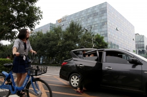 Didi launches delivery service as virus crimps ride-hailing