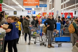 Walmart to hire 150,000 workers as shoppers rush to stock up