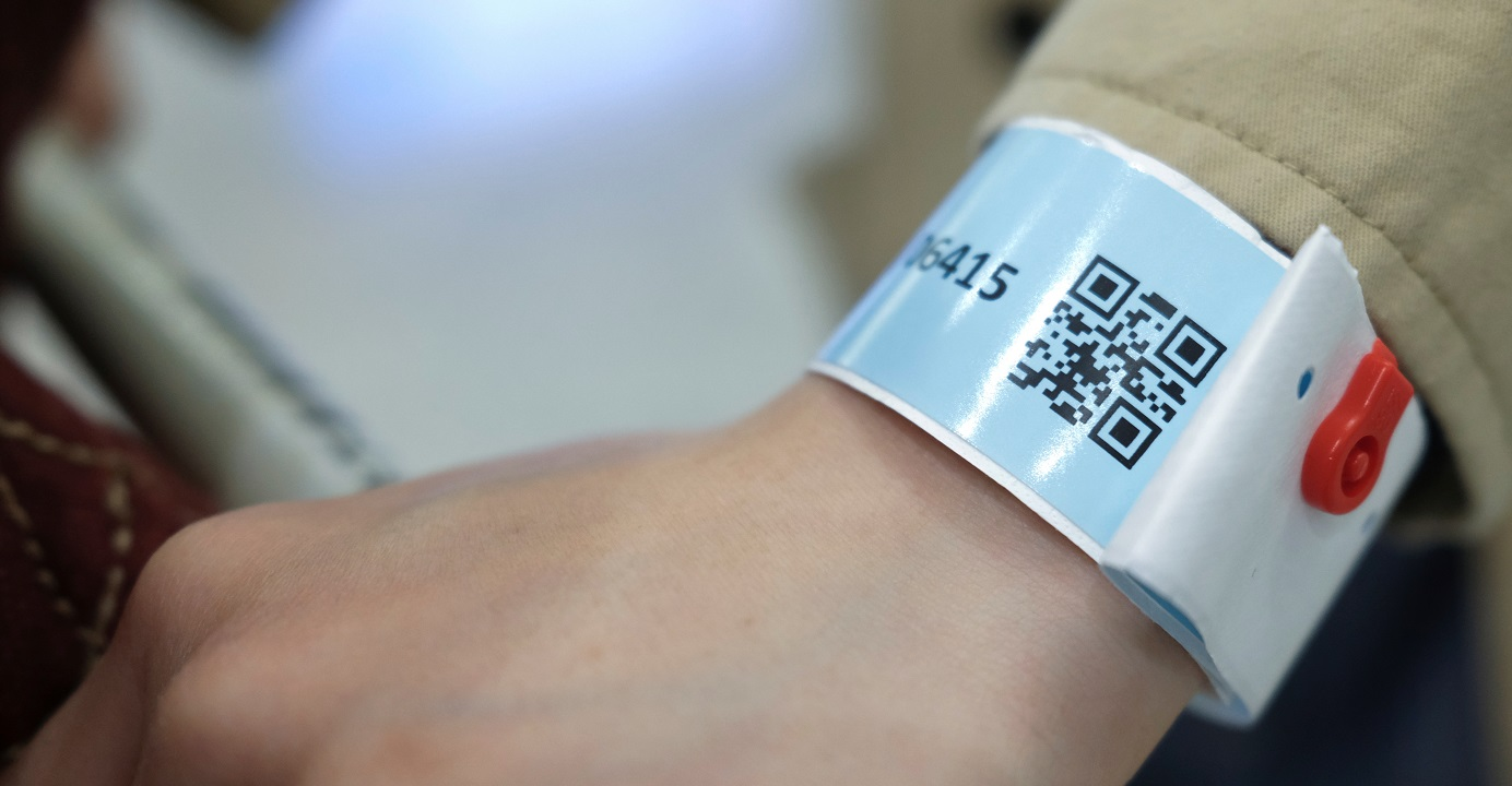 A passenger is made to wear an electronic wristband  upon arrival at Hong Kong International Airport as a means to monitor their location amid the coronavirus outbreak. Photo: Reuters