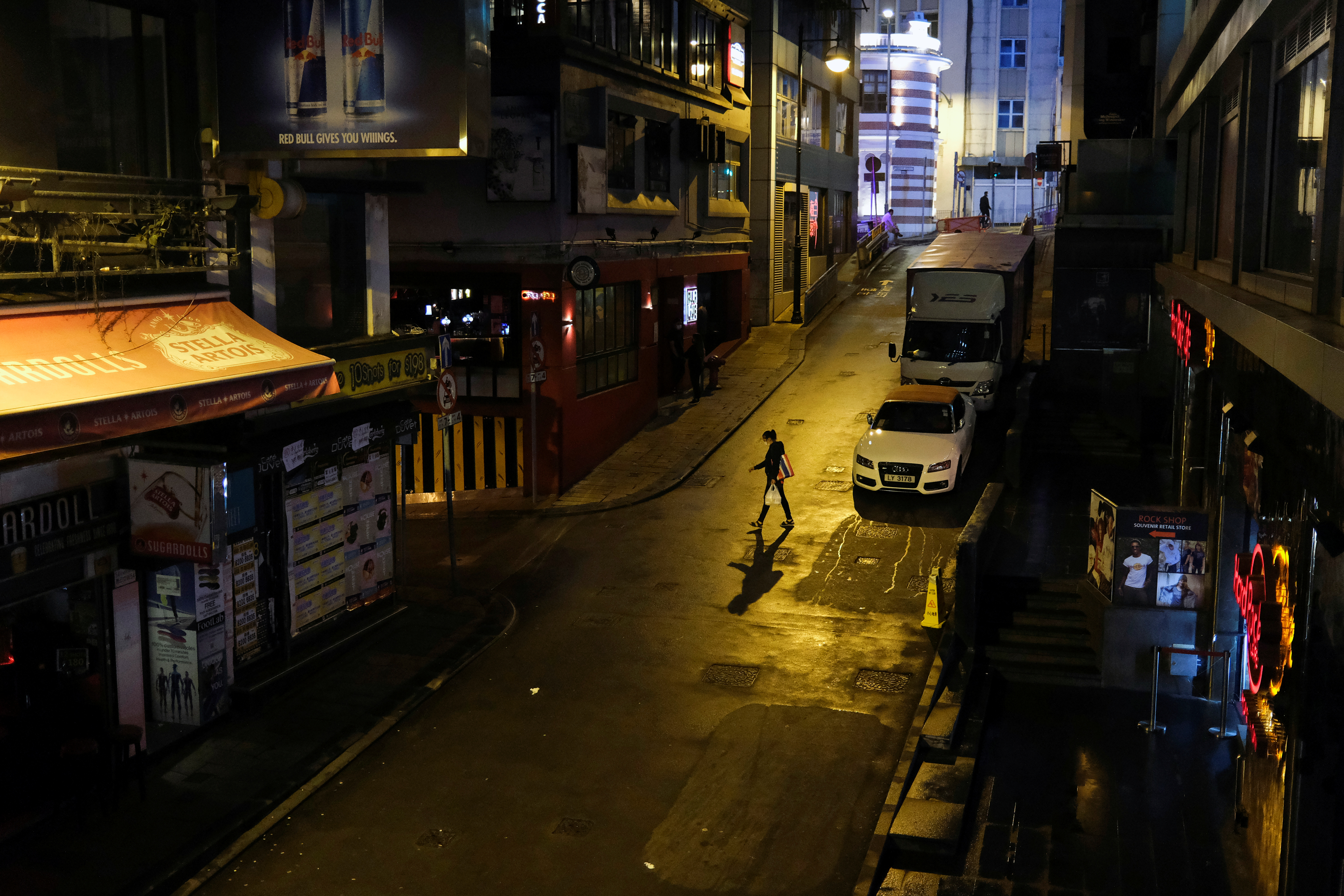A person walks past an almost empty pub area at Lan Kwai Fong  in Hong Kong on March 20 amid the coronavirus outbreak. Photo: Reuters