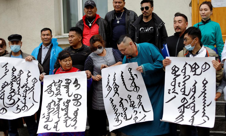 Demonstrators, holding signs with Mongolian script, protest against a phased program to replace Mongolian as the medium of instruction in schools with Chinese.  Photo: Reuters