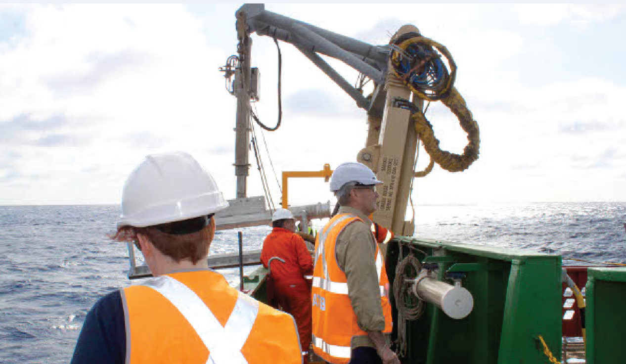 Megan McCabe (foreground), based in Australia, observes the ocean scene aboard a survey vessel in the search for the Malaysian aircraft MH370.  Photo: Courtesy of Esri Press