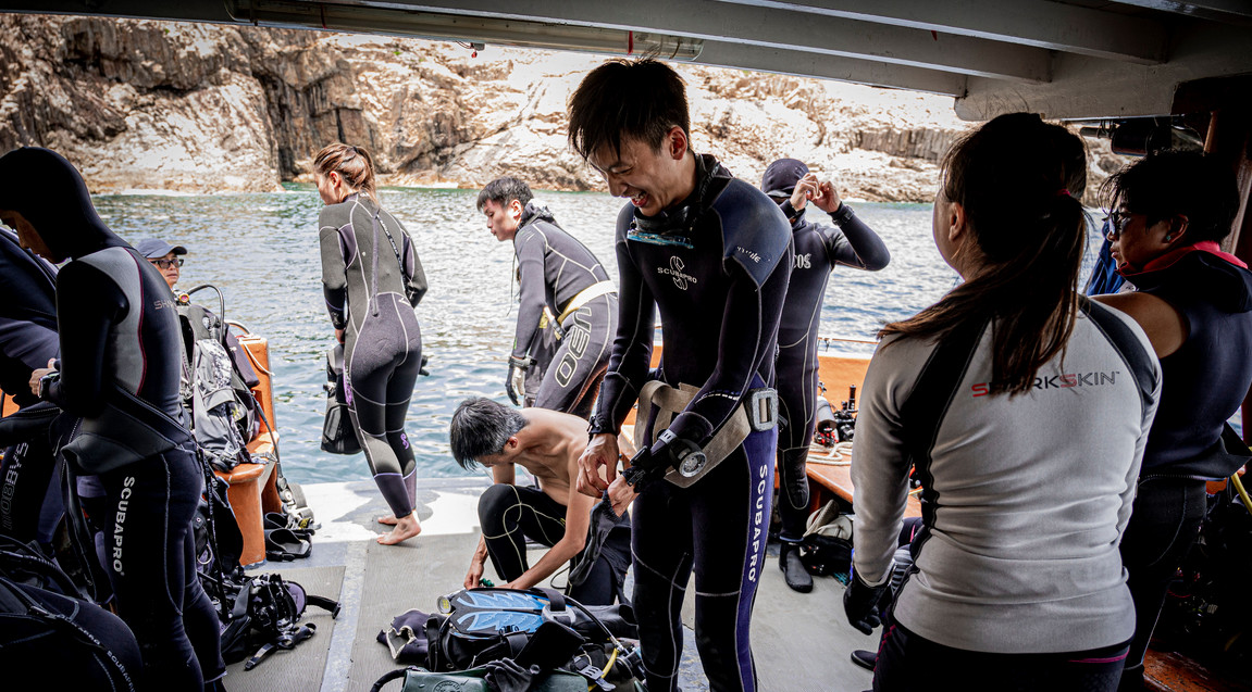 National Geographic explorers work with local teams of citizen scientists to conduct an underwater survey on Hong Kong reef fish. Photo: Swire